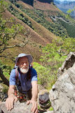 Old male climber in mountains Stock Photo
