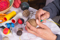 Old male hand sewing Stock Photos