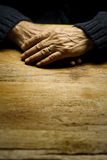 Old Male Hands. On a table in a vertical composition Stock Photos