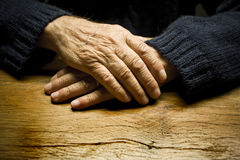 Old Male Hands. On a table horizontal composition Stock Photos