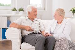 Old male having professional care. Photo of old male having professional medical care Royalty Free Stock Photo