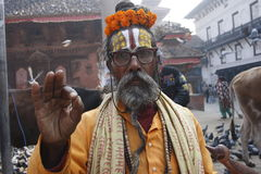 Old man. Old beggar in traditional clothes in Durbar Square, center of Kathmandu, Nepal Royalty Free Stock Photos