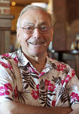 Old man. Portrait of an old senior man smiling wearing glasses stock image