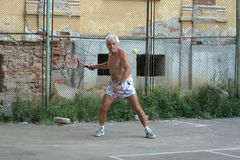 Old man. Active and healthy old man playing tennis Stock Images