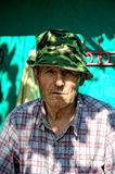 Old man. Old expresive man with hat and shirt Royalty Free Stock Images