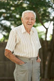 Old man. Happy 90 year old senior man standing outside royalty free stock images