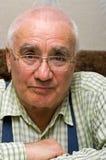 Old man. Smiling elderly man in glasses Royalty Free Stock Image