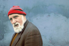 Old man. Portrait of an old man with the red hat royalty free stock photography