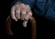 Old man. Holding walking stick royalty free stock photography