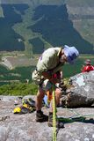 Old man adjust gear for rope climbing Royalty Free Stock Photography