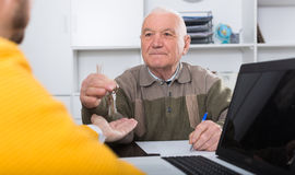 Old man and agent sign lease contract Stock Photos