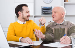 Old man and agent sign lease contract Stock Photography
