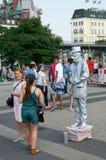 A old man animator in metallic silver costume. Hamburg Stock Photo