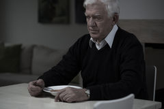 Old man without appetite. Picture of old, sad man without appetite stock image
