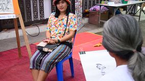 Old man artist drawing and sketch thai woman stock video footage