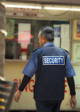 An Old Man As Security Person. A security person patrolling around the area. Kuala Lumpur, Malaysia Royalty Free Stock Images