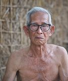 Old man. Asia old man living in the countryside The way of life of rural people in Thailand royalty free stock image