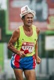 Old man athlete running last effort Royalty Free Stock Image