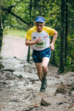 Old man athlete running uphill Stock Photography