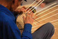 Old man Basket weaving from bamboo Royalty Free Stock Photography