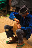 Old man Basket weaving from bamboo Stock Photos
