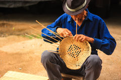 Old man Basket weaving from bamboo Royalty Free Stock Photo