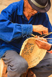Old man Basket weaving from bamboo Royalty Free Stock Images