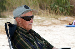 Old man by the beach Stock Photography