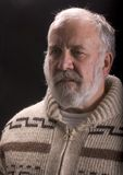 Old man with beard in sweater Royalty Free Stock Photo