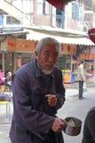 Old man beggar begging Royalty Free Stock Image