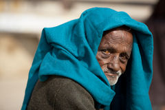 Old man beggar with head scarf begging in India Royalty Free Stock Images