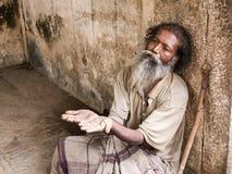 Old man begging. Royalty Free Stock Photos