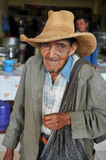 Old man begging at a local street market Royalty Free Stock Images