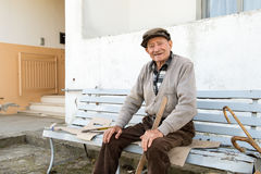 Old man on the bench Stock Photo