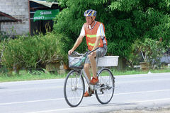 Old man on bicycle. Royalty Free Stock Images