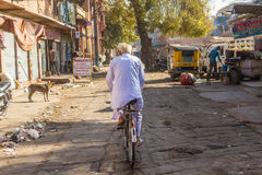 Old man on a bicycle Stock Photo