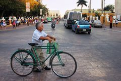 Old man with a bike in the street of Valladolid royalty free stock image