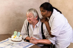 Old man with birthday cake Stock Photo