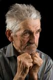 Old man on black background. Portrait of an old man isolated on black Royalty Free Stock Photography