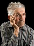 Old man on black background Stock Photos