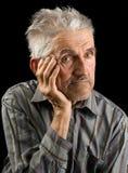 Old man on black background Stock Photos