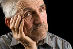 Old man on black background Stock Photo