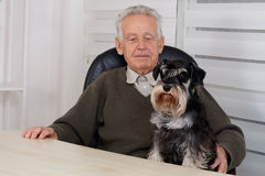 Old man with black Miniature Schnauzer Dog Royalty Free Stock Photo