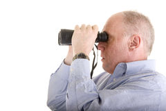 Old Man in Blue Shirt Looking Through Binoculars Stock Photos