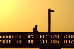 Old man on boardwalk Royalty Free Stock Photos