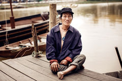 Old man on a boat in river, Vietnam. Stock Photos
