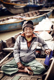 Old man on a boat in river, Vietnam. Royalty Free Stock Photography