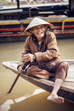 Old man on a boat in river, Vietnam. Stock Images
