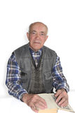 Old man with a book. Half-length portrait of an old man with a book isolated on white background Stock Images