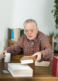 Old man with books Stock Photography